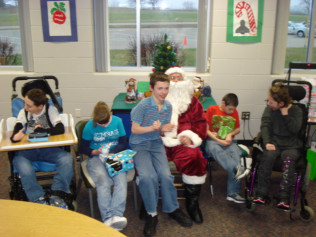ROOSEVELT STUDENTS WITH SANTA CLAUS